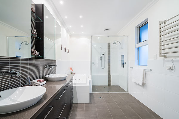 stock photo large modern bathroom interior with floor to ceiling tiling and luxury fittings 1005799651 klein